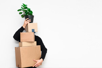 Man with box moving in a new apartament. Moving concept.