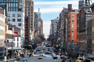 View of a busy 14th Street in the Chelsea neighborhood with people and traffic in New York City NYC