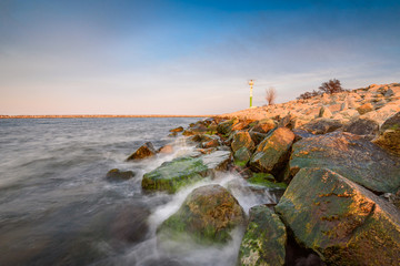 Sea waves crashing against the rocks in Gorki Zachodnie, Baltice Sea, Gdansk, Poland.