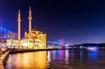 Ortakoy Mosque and Bosphorus Bridge (15th July Martyrs Bridge) night view. Istanbul, Turkey..