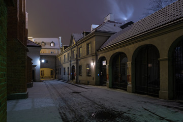 Street of the old town of Warsaw in the winter night