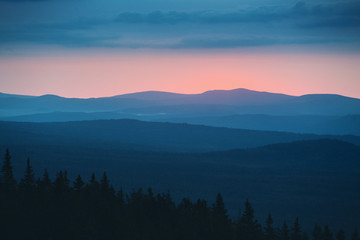 dramatic natural sunset in the wild rocky mountains of the Urals, Russia