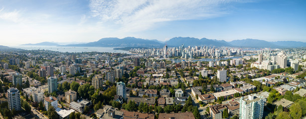 Aerial Panoramic view of a modern city during a sunny summer day. Taken in Vancouver, BC, Canada.