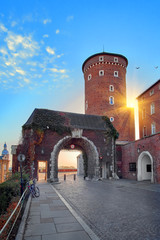Ancient tower gates of Wawel Royal Castle in Krakow, Poland in beautiful sunset light