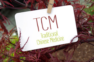 Red japanese maple with card board and TCM traditional Chinese medicine