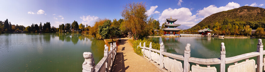 The white marble bridge in Black Dragon Pool in Jade Spring Park, Lijiang, Yunnan, China. It was built in 1737 during the Qing dynasty