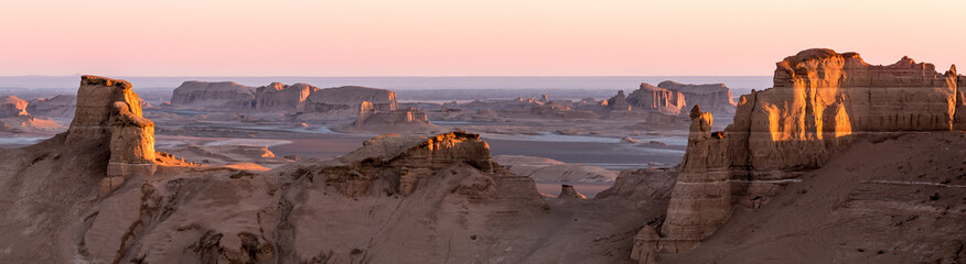 Panoramic view of sandy mountains in Kaluts desert, part of Dasht-e Lut desert during sunrise, Iran