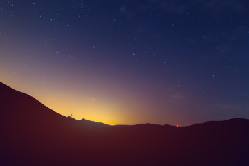 Starry sky in the mountains. Night in nature. Sky