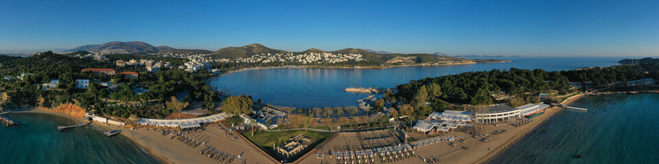 Aerial drone photo of iconic turquoise sandy celebrity beach of Asteras or Astir and ancient temple of Apollo Zoster, Vouliagmeni, Athens riviera, Attica, Greece