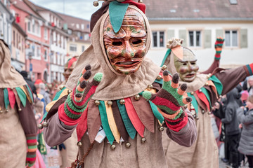 Friendly carnaval figure shows hands. Street carnival in southern Germany - Black Forest.
