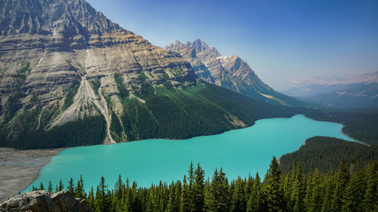 Peyto Lake in Alberta at Banff National Park in Canada with Glacier and Turquoise Green Water and Smoky Sky