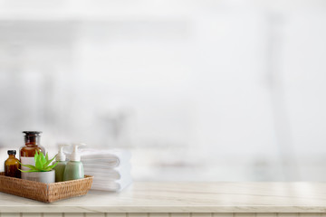 Ceramics shampoo or soap, Towels on top marble counter with copy space on bathroom background.