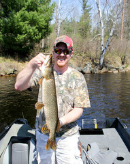 Fisherman holding a Northern Pike