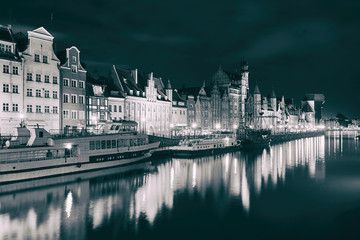Night view of Gdansk harbor and Motlawa river, located in the Old Town of Gdansk city, Poland