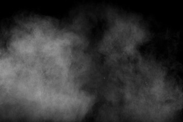 Abstract white powder explosion against black background.White dust exhale in the air.