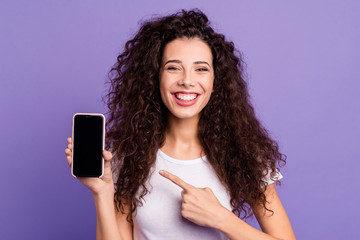 Close-up portrait of nice cute attractive winsome lovely cheerful wavy-haired lady showing new product ad promotion isolated on bright vivid shine violet pastel background