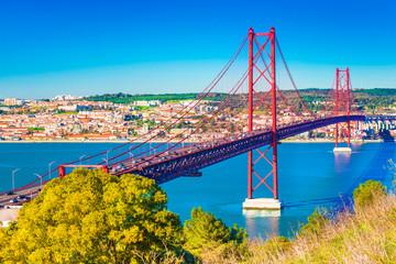 The 25th April Bridge (Ponte 25 de Abril) in Lisbon, Portugal. View from Almada