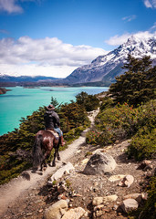 Riding in Patagonia. Man riding a horse in a snowy landscape. Enjoying nature in Patagonia, Chile.
