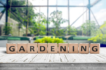 Gardening sign in a green house on a wooden