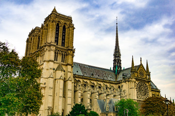 Exterior of Notre Dame de Paris cathedral in cloudy blue sky day