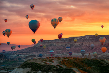 Hot Air balloons flying tour over Mountains landscape spring sunrice Cappadocia, Goreme Open Air Museum National Park, Turkey nature background.