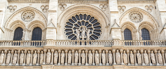 The western facade of catholic cathedral Notre-Dame de Paris. Built in French Gothic architecture, and it is among the largest and most well-known church buildings in the world