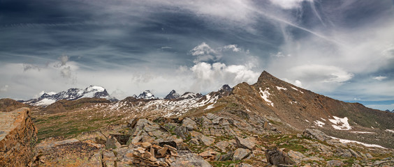 Panoramic view of the Violetta peak in the background the glacier and the peaks of the Gran Paradiso, in Italy.
