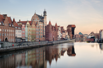 Old town of Gdansk in the early morning: an embankment and famous crane Zurav.