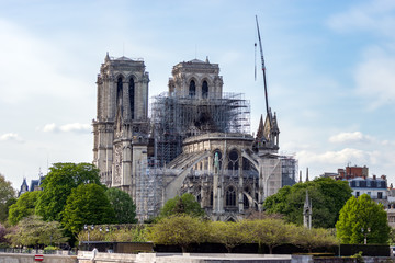 Paris, France - April 17, 2019: Notre Dame de Paris, the day after. Reinforcement work in progress after the fire, to prevent the Cathedral to collapse.fter the fire