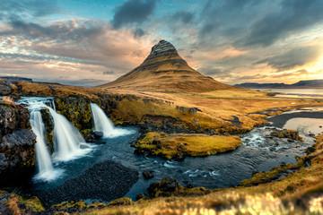 Colorful sunrise landscape view on Kirkjufellsfoss waterfall. Amazing morning scene near Kirkjufell volkano, Iceland, Europe.