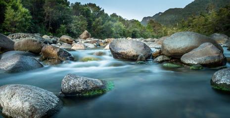 cascading river through forest valley, Coromandel, New Zealand