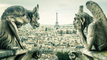 Gargoyles on Notre Dame de Paris overlooking the Paris city, France