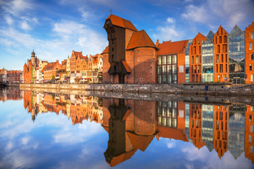 Old town of Gdansk reflected in the Motlawa river at sunrise, Poland.