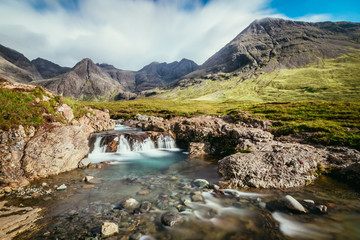 Beautiful waterfalls scenery on the Isle of Skye, Scotland: The Fairy Pools, Glen Brittle, Scotland