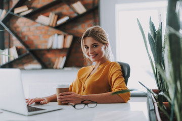 Beautiful business woman at the workplace in modern office