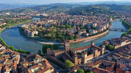 Aerial drone photo from iconic fortified medieval castle and bridge of Castelvecchio used as a museum, Verona, Italy