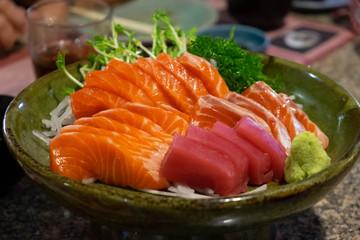 Raw salmon slice or salmon sashimi in Japanese style fresh serve with fresh wasabi.
