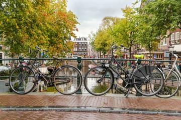 Bikes on bridge over Amsterdam canal, Amsterdam, Netherlands