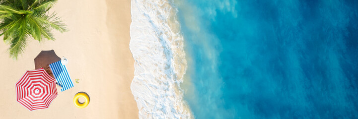 Aerial view of umbrella,towel on sand beach