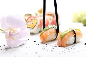 Sushi. Nigiri with salmon and avocado. Traditional Japanese cuisine