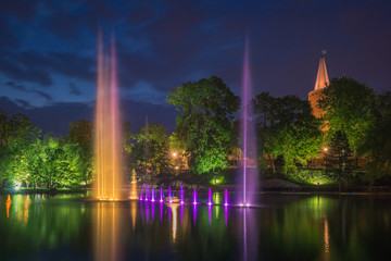 Piastowska tower and fountain in the castle pond at night in Opole, Opolskie, Poland