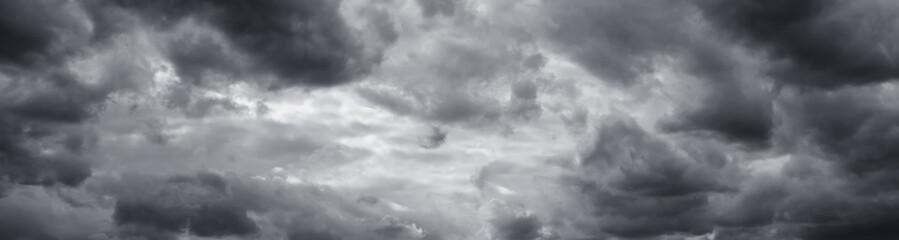 Panorama of beautiful thunder clouds. Rainy clouds over horizon.