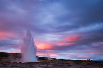Strokkur Geysir Eruption with Dark Cloudy Sky, Iceland