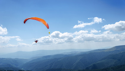 Paraglider in the blue sky.