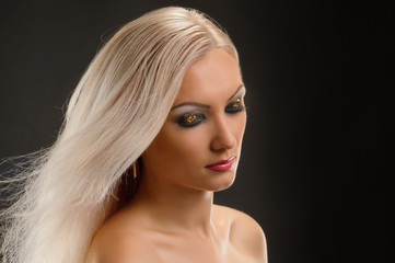Beautiful woman with straight hair and bright evening makeup