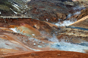 Seltun geothermal area in Iceland. Bubbling mud pools and steaming hot springs.