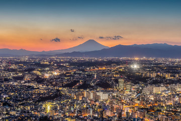 Yokohama city at night time and Mt.Fuji in sunset