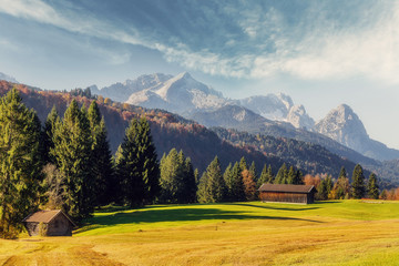 Stunning landscape at Alpine valley. Awesome sunny day in the Bavarian Alps with perfect sky under sunlit. Incredible European alps in Germany. Zugspitze on background. Wonderful natural Background