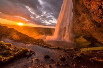 sunset hitting the waterfall iceland