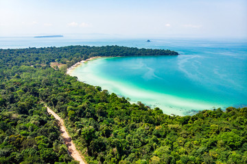 Top view of a beautiful tropical island with dense forest or jungle. long beach in tropical paradise snake island near sihanoukville cambodia